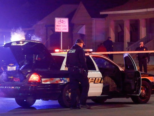 "Wichita police investigate a call of a possible hostage situation near the corner of McCormick and Seneca in Wichita, Kan., Thursday night. A man was fatally shot by a police officer in what is believed to be a gaming prank called ""swatting."""
