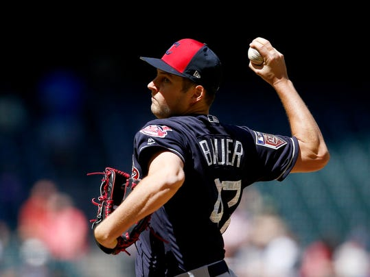 Cleveland Indians starting pitcher Trevor Bauer throws a pitch against the Arizona Diamondbacks during the first inning of a spring training baseball game Tuesday, March 27, 2018, in Phoenix. (AP Photo/Ross D. Franklin)
