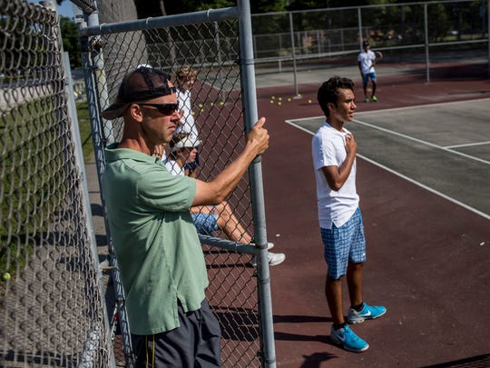 Port Huron Northern tennis coach Chris Smith watches players during tennis practice Tuesday, August 30, 2016 at Port Huron Northern High School.