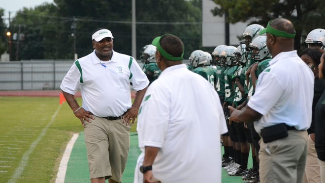 Toriano Williams (left), who was the 2014 All-Cenla Coach of the Year after leading Peabody to its first playoff win in five decades, was hired as Delhi's coach Thursday.
