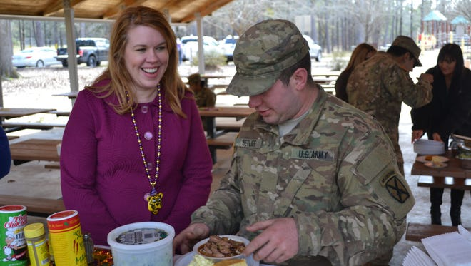 Miranda Shumate visits with her son, PFC. Morley Setliff. Shumate served a gumbo dinner as a treat for her son and the 150 members of his Army company Saturday while they were training at Fort Polk.