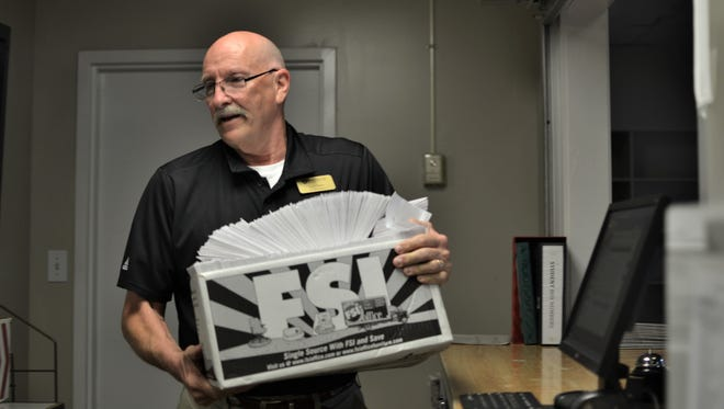 Scott Taylor takes in hundreds of letters and parcels a day, organizing packages and making sure pieces of mail coming in and heading out of Anderson University get to where they need to be.