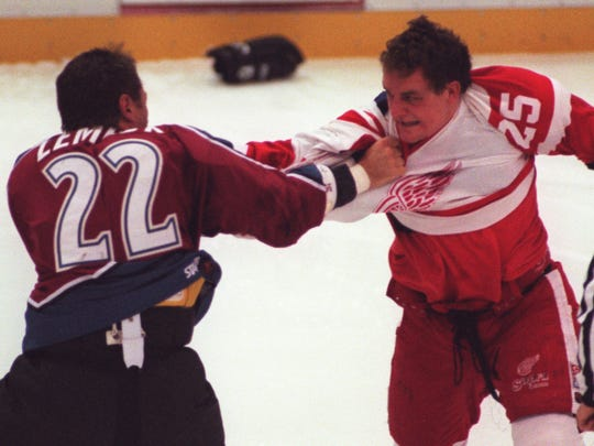 Red Wings forward Darren McCarty and Colorado Avalanche forward Claude Lemieux duke it out three seconds into a game at Joe Louis Arena on Nov. 11, 1997.