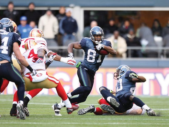 Nate Burleson (No. 81) of the Seattle Seahawks runs with the ball for yardage during their NFL game against the San Francisco 49ers on Dec. 6, 2009 at Qwest Field in Seattle, Washington. The Seahawks defeated the 49ers 20-17.