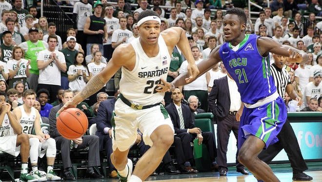 Michigan State Spartans' Miles Bridges drives the baseline against Florida Gulf Coast's Demetris Morant during the second half of MSU's 78-77 win Sunday, Nov. 20, 2016 at Breslin Center.