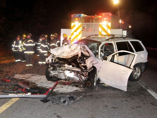 Emergency personnel work the scene after a fatal two-car collision on Interstate 495 southbound Nov. 24 in Plainville, Mass. (Photo: Mark Stockwell, AP)