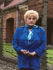 Eva Kor is shown in a scene at the Auschwitz concentration