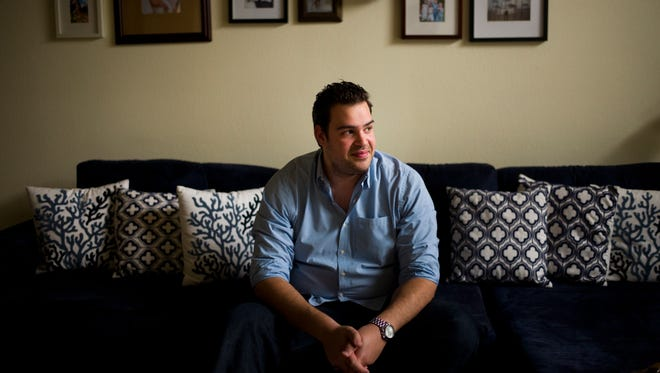 Weberous Web Design CEO Rafael Romis poses for photos in his home, in Los Angeles. When Romis started his website design company five years ago, he kept enough cash on hand to last about two weeks. That worked well until the company's income taxes had to be paid.