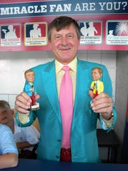 Craig Sager visited the Fort Myers Miracle in June, 2013, when he held the two bobbleheads in his likeness.