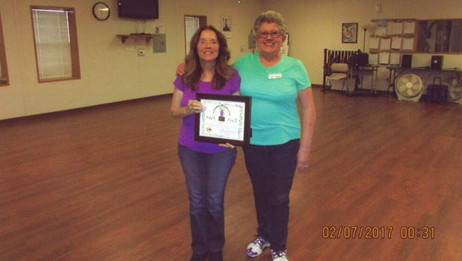 Dog Canyon Line Dance Instructor Bea Smith, right, presents the Outstanding Line Dancer award to Emilia Hanson, left, for demonstrating the ability to do all 40 of New Mexico's official line dances without help. Emilia is the third person to receive this award in the 11 year history of the Dog Canyon Dancers.