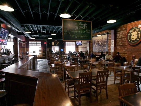Wooden columns and chairs and exposed brick give Royal Oak Brewery a classic feel.