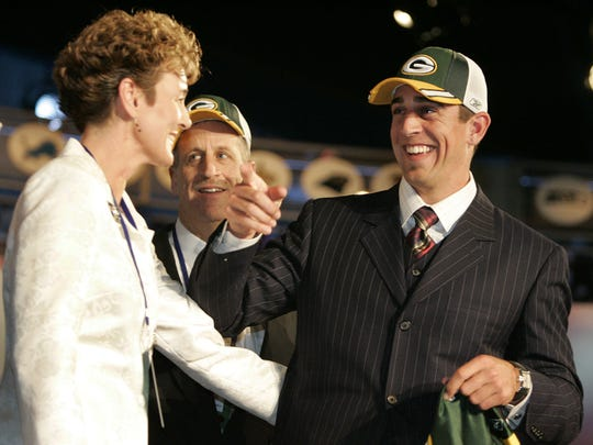 Aaron Rodgers, right, gathers with family members incouding his mom Darla Rodgers, left,  after being selected by the Green Bay Packers as the 24th overall pick in the NFL draft Saturday, April 23, 2005 in New York.
