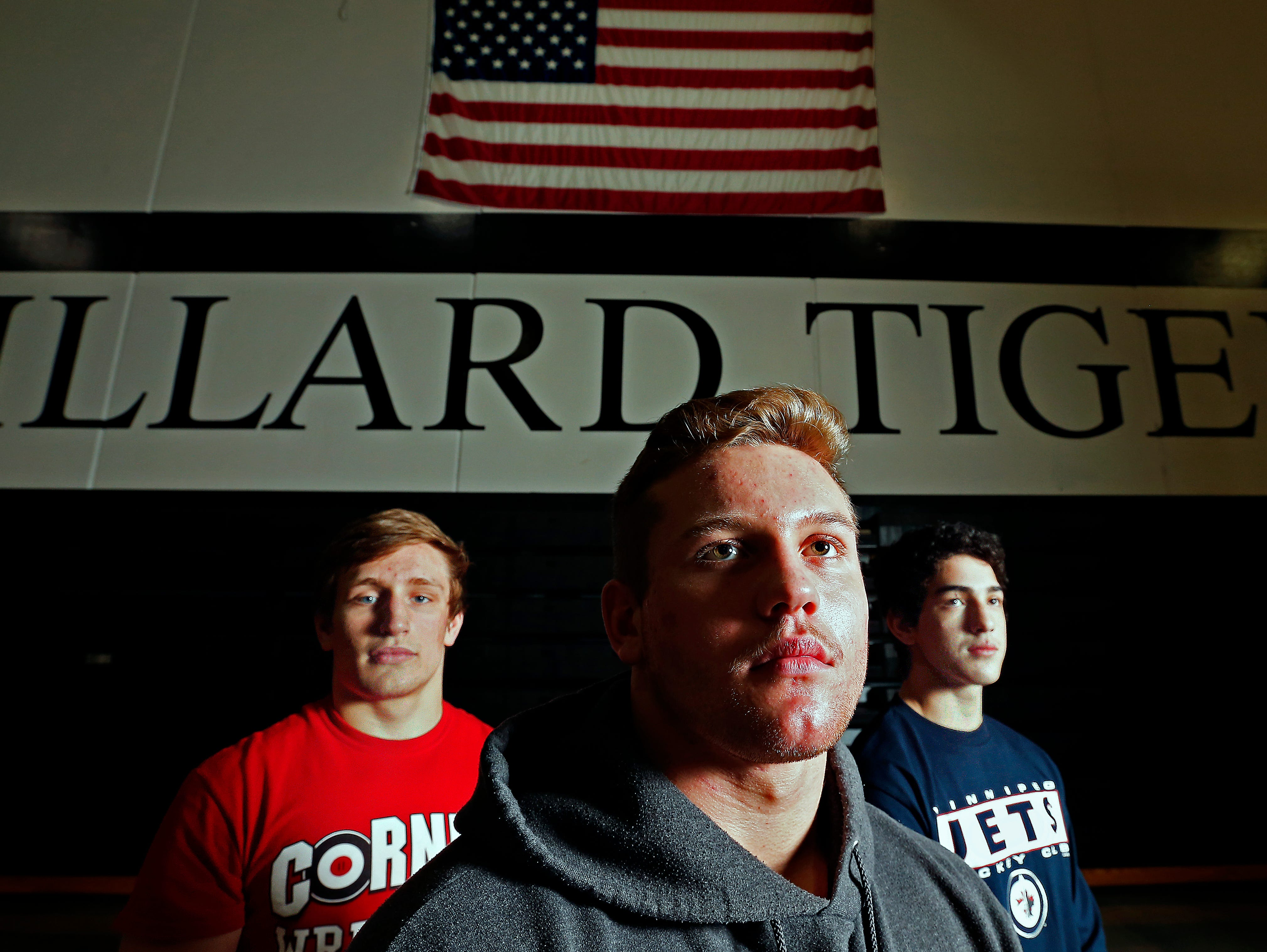 Willard High School wrestlers (from left) Kyle Caldwell, Hunter Yeargan and Niko Chavez took a break from training for the state wrestling tournament to pose for a portrait at the Willard High School gym in Willard, Mo. on Feb. 16, 2016.
