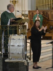 Patricia Sebranek, interpreter for the deaf, signs
