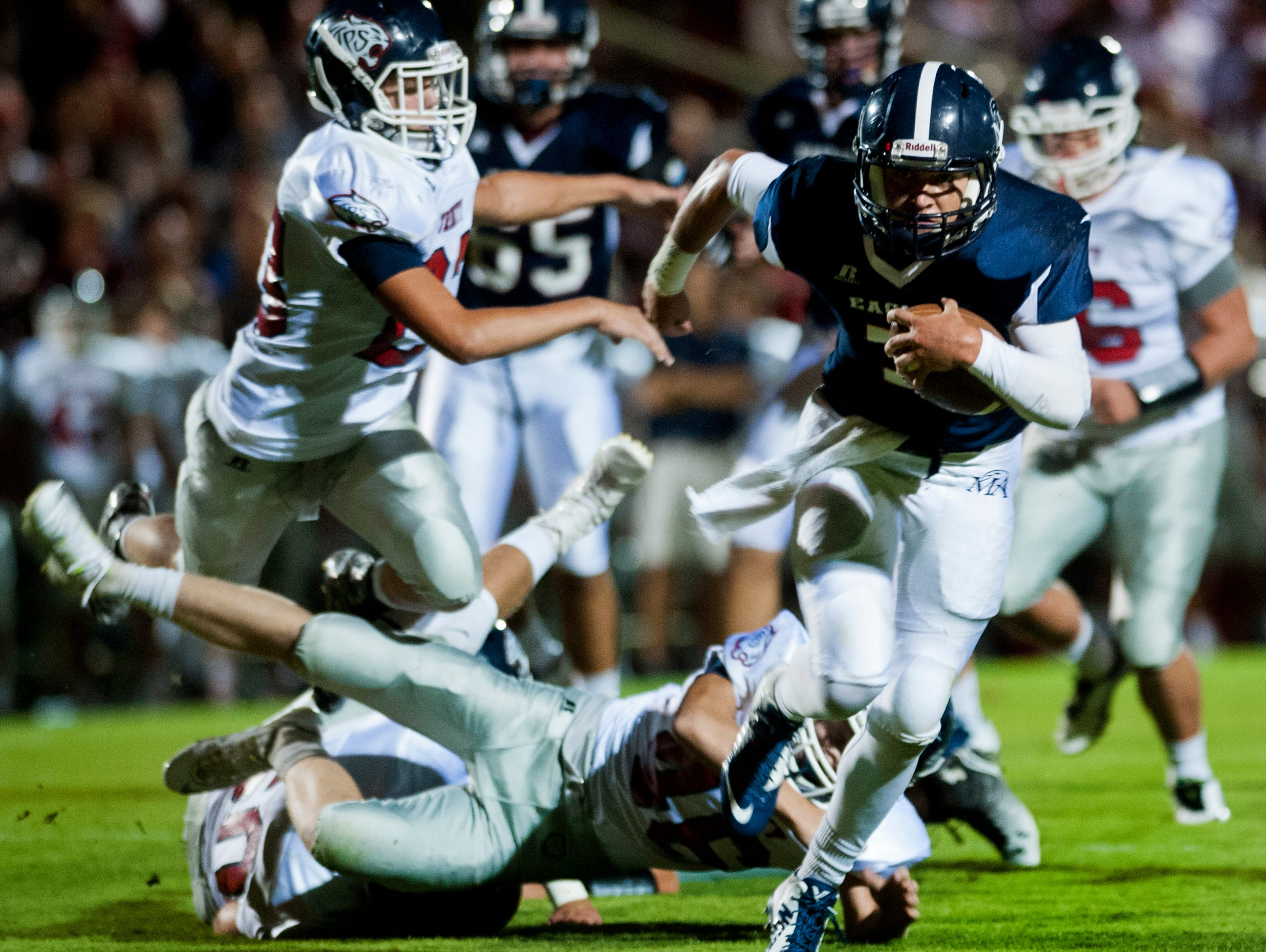 Montgomery Academy's Barton Lester breaks away for a long touchdown run in the first quarter against Trinity at the Montgomery Academy campus in Montgomery Al. on Friday September 25, 2015.