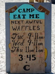 A sign at Burning Man 2017 tells participants when they can stop by this camp for special waffles, flavored with insects, macaroni and cheese or ludicrously hot hot sauce.