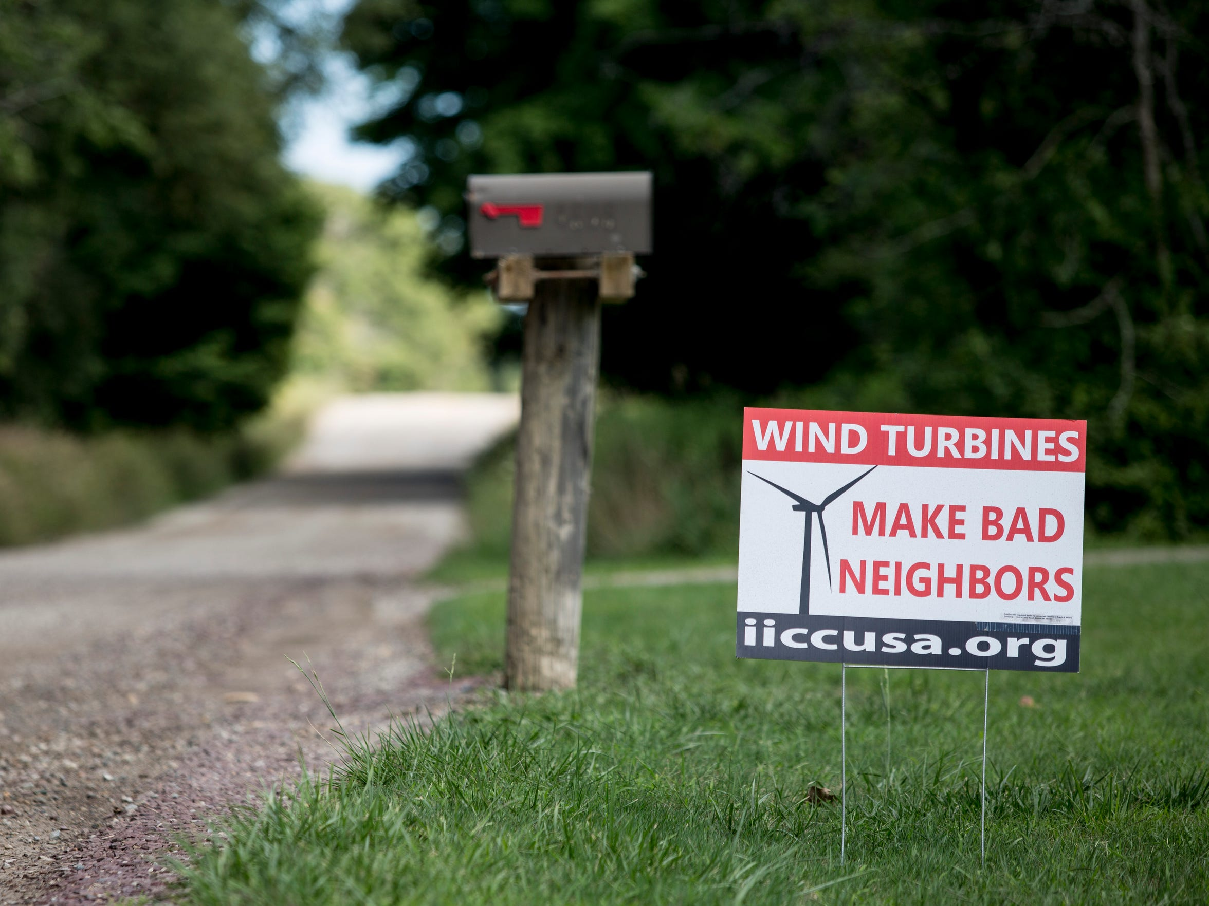An anti-wind turbine sign is posted in Roger Knight's yard Thursday, August 18, 2016 in Bridgehampton Township.