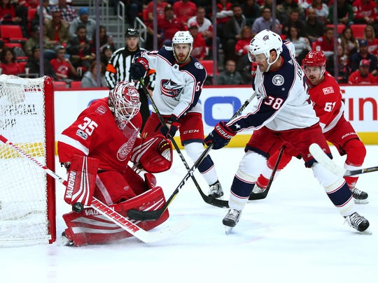The Blue Jackets' Boone Jenner tries to gets a shot off on Red Wings goalie  Jimmy Howard during the first period on Saturday, Nov. 11, 2017, at Little Caesars Arena.