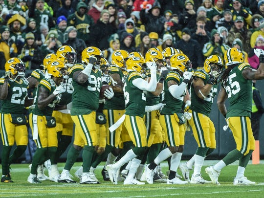 Nov 10, 2019; Green Bay, WI, USA;  The Green Bay Packers defense celebrates after recovering a fumble in the second quarter during the game against the Carolina Panthers at Lambeau Field. Mandatory Credit: Benny Sieu-USA TODAY Sports