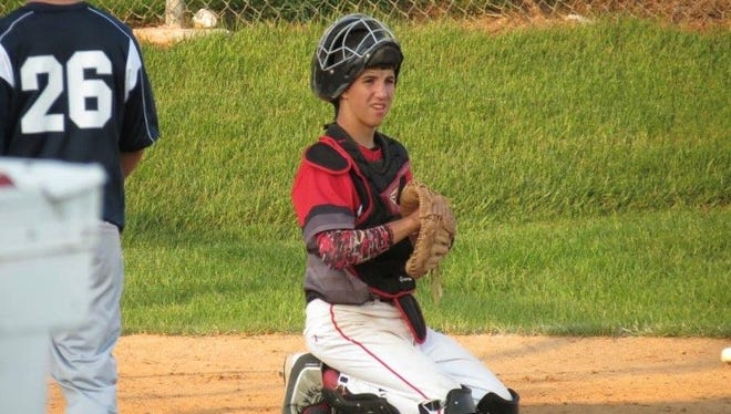 Brayden Smith, 17, is a catcher on the Dover American Legion baseball team. He is managed by his older brother, Bryce, who is 21. SUBMITTED PHOTO