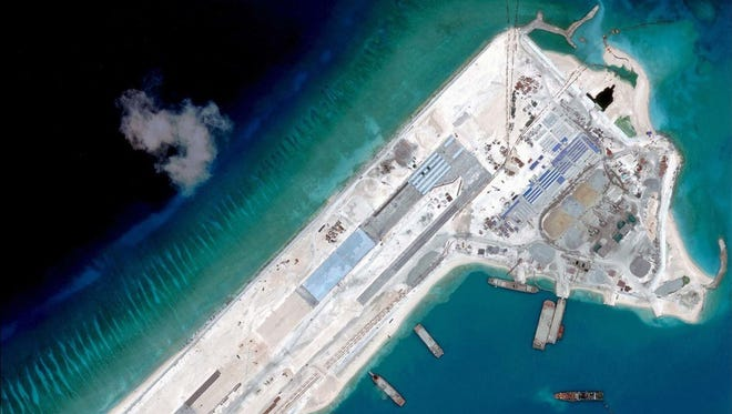 A satellite image of what is claimed to be an under-construction airstrip at Fiery Cross Reef in the Spratly Islands in the disputed South China Sea.