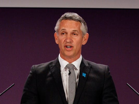 FILE- In this Tuesday, April 24, 2012, file photo, former Engalnd soccer player Gary Lineker speaks ahead of the draw for the London 2012 Olympic Soccer tournament, at Wembley Stadium in London. FIFA has announced Friday Nov. 17, 2017, that Lineker and Russian sports journalist Maria Komandnaya will jointly present the World Cup draw in Moscow on Dec. 1. (AP Photo/Kirsty Wigglesworth, FILE)