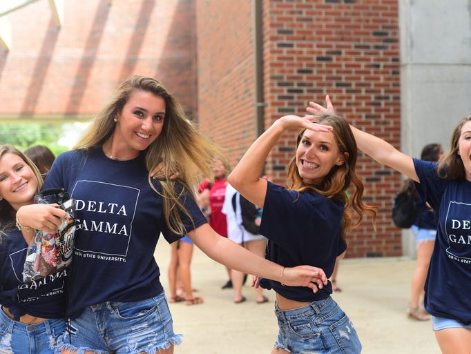 Sisters of the Delta Gamma soroity pose outside of