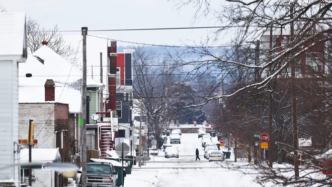 Many side streets in New Albany  were covered with about two inches of snow Tuesday morning, Jan. 16.