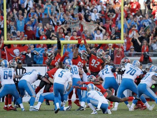 Detroit Lions kicker Matt Prater (5) kicks what proved