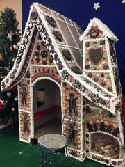 Every year, Clasen's bakery creates a life-size gingerbread house that children can go into.