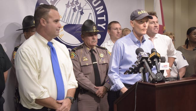 Gov. Rick Scott, local and state officials hold a press briefing on Friday, Oct. 6, 2017, in Pensacola on Tropical Storm Nate.
