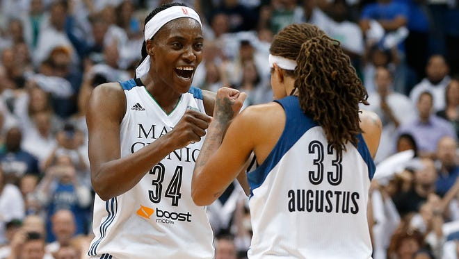 Minnesota Lynx center Sylvia Fowles celebrates with Seimone Augustus after beating the Indiana Fever 69-52 in Game 5 of the WNBA basketball finals.