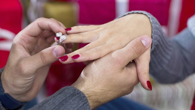 The holiday season is one of the most popular times for couples to get engaged.