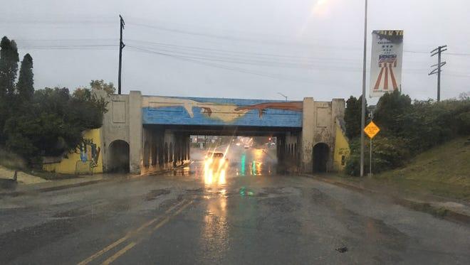 The Madison Street underpass during heavy rain Thursday Oct. 5, 2017.
