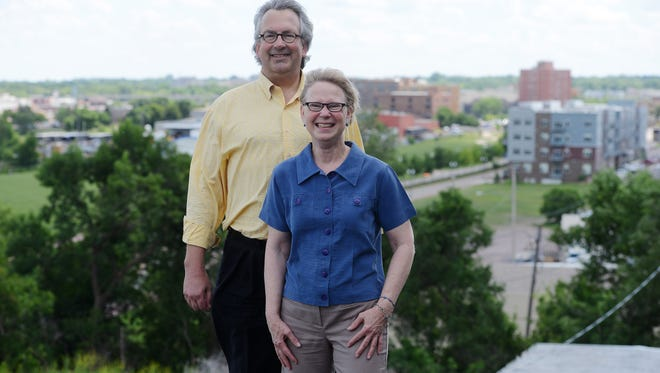 Jeff and Sheila Hazard overlooking downtown from the roof at The Bakery on North Main Avenue.