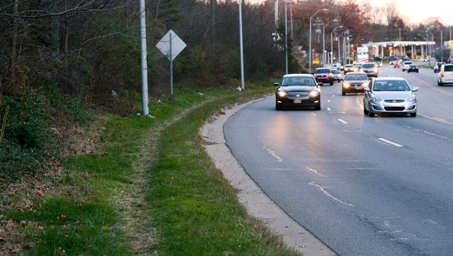 A path in the grass has been formed from pedestrians walking along New Leicester Highway near The Meadows Apartments. The city recently received a grant to build sidewalks on the side of the highway.