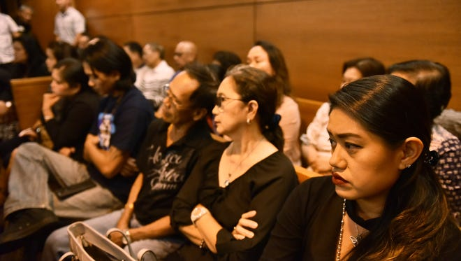 A hearing continued on Friday, Jan. 28, in the Mark Torre Jr. murder trial on the defense motion to exclude a police body camera as evidence. Victim Elbert Piolo's widow, Mika, right, and other family members watch the proceedings. 