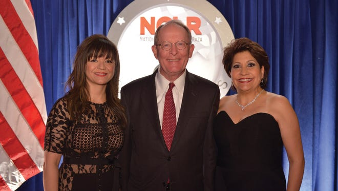 Renata Soto, chair of the NCLR board, stands with Sen. Lamar Alexander, who was honored Tuesday, March 8, 2016, at the NCLR Capital Awards in Washington, D.C., for his leadership in passing the Every Student Succeeds Act, landmark legislation that provides needed updates to the Elementary and Secondary Education Act of 1965.
