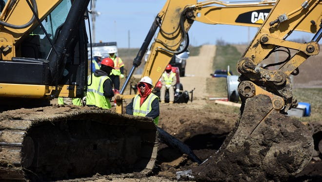 A TransCanada crew works at the site of the oil pipeline leak near Freeman on Friday, April 8, 2016.
