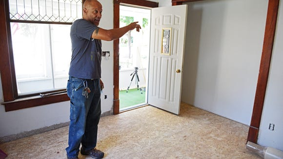 George Hamilton shows a property in the All Saints Neighborhood that he is renovating Friday, July 29, 2016, in Sioux Falls.