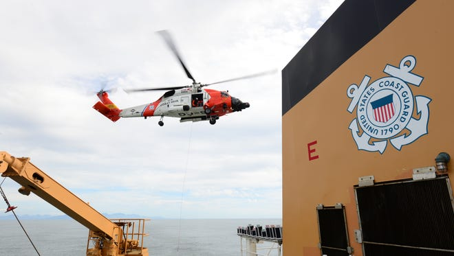 A Coast Guard aircrew aboard an MH-60 Jayhawk helicopter from Air Station Astoria.