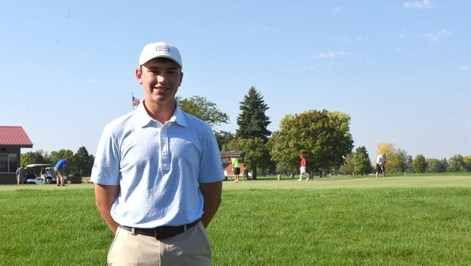 O'Gorman's Bryce Hammer poses in front of the practice greens at Elmwood Golf Course in Sioux Falls.