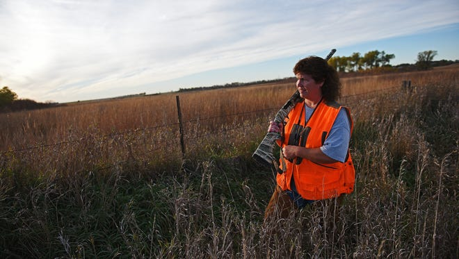 Carol Bothe, of Brandon, S.D., walks a piece of cover while hunting during the South Dakota pheasant hunting opener Saturday, Oct. 15, 2016, on her family's farm near Brookings, S.D.