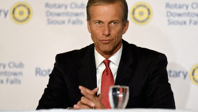 Republican incumbent John Thune, candidates for a U.S. Senate seat from South Dakota, debates with Democratic challenger Jay Williams during a meeting for the Rotary Club Downtown Sioux Falls at the Holiday Inn Sioux Falls City Centre.