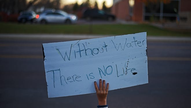 Ohana Owings, 9, of Sioux Falls, takes part in a protest against the Dakota Access Pipeline as part of a worldwide day of action in support of the efforts of the Standing Rock Sioux Tribe Tuesday, Nov. 15, 2016, in Sioux Falls. More than 100 people took part in the protest, which marched from Summit Avenue and 33rd Street to Minnesota Avenue, up to 26th Street, back over to Summit Avenue and then ended on the Augustana University campus.