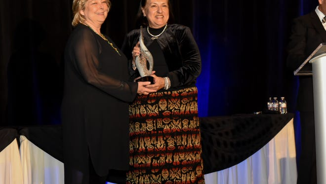 Ruidoso tourism director Gina Kelley, left, accepts the New Mexico Hospitality Association's top award.