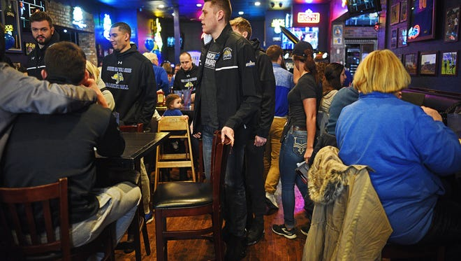 SDSU's Mike Daum finds his seat at the start of a NCAA Tournament Selection Show Watch Party Sunday, March 12, 2017, at Cubby's Sports Bar and Grill in Brookings, S.D. SDSU will play Gonzaga in the first round of the NCAA tournament Thursday in Salt Lake City.