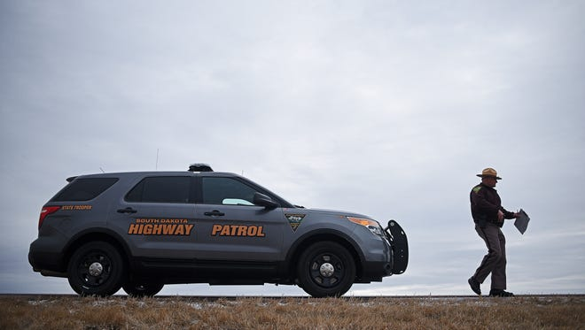 State Trooper Kristoff DeKramer, with the South Dakota Highway Patrol, approaches a vehicle after pulling the driver over for speeding Wednesday, March 22, 2017, on Interstate 90 west of Sioux Falls.