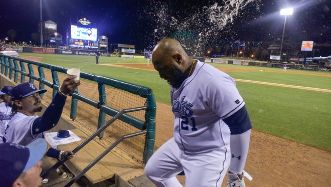 Hooks infielder Jon Singleton his hit with water after his grand slam in the sixth inning on Saturday, May 13 at Whataburger Field.