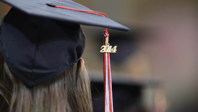 File photo taken in 2014 shows a graduate of Northwest Florida State College wears her graduation cap at the school's commencement ceremony in Niceville, Fla.